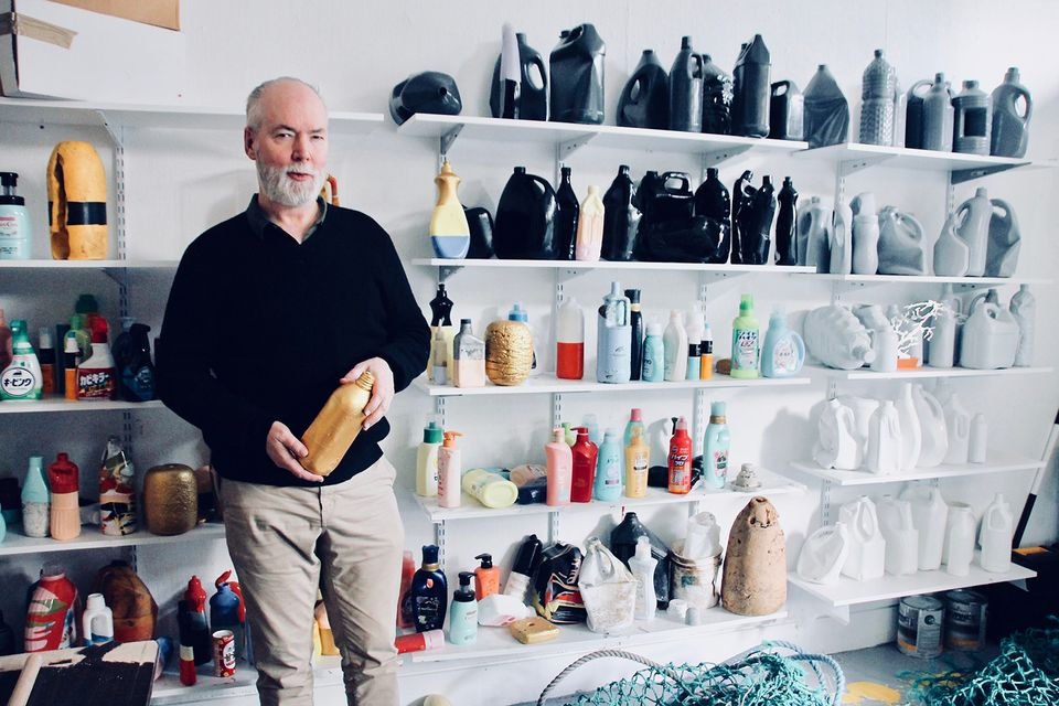 Douglas Coupland in his studio with some of of the hundreds of plastic objects he has collected over the years