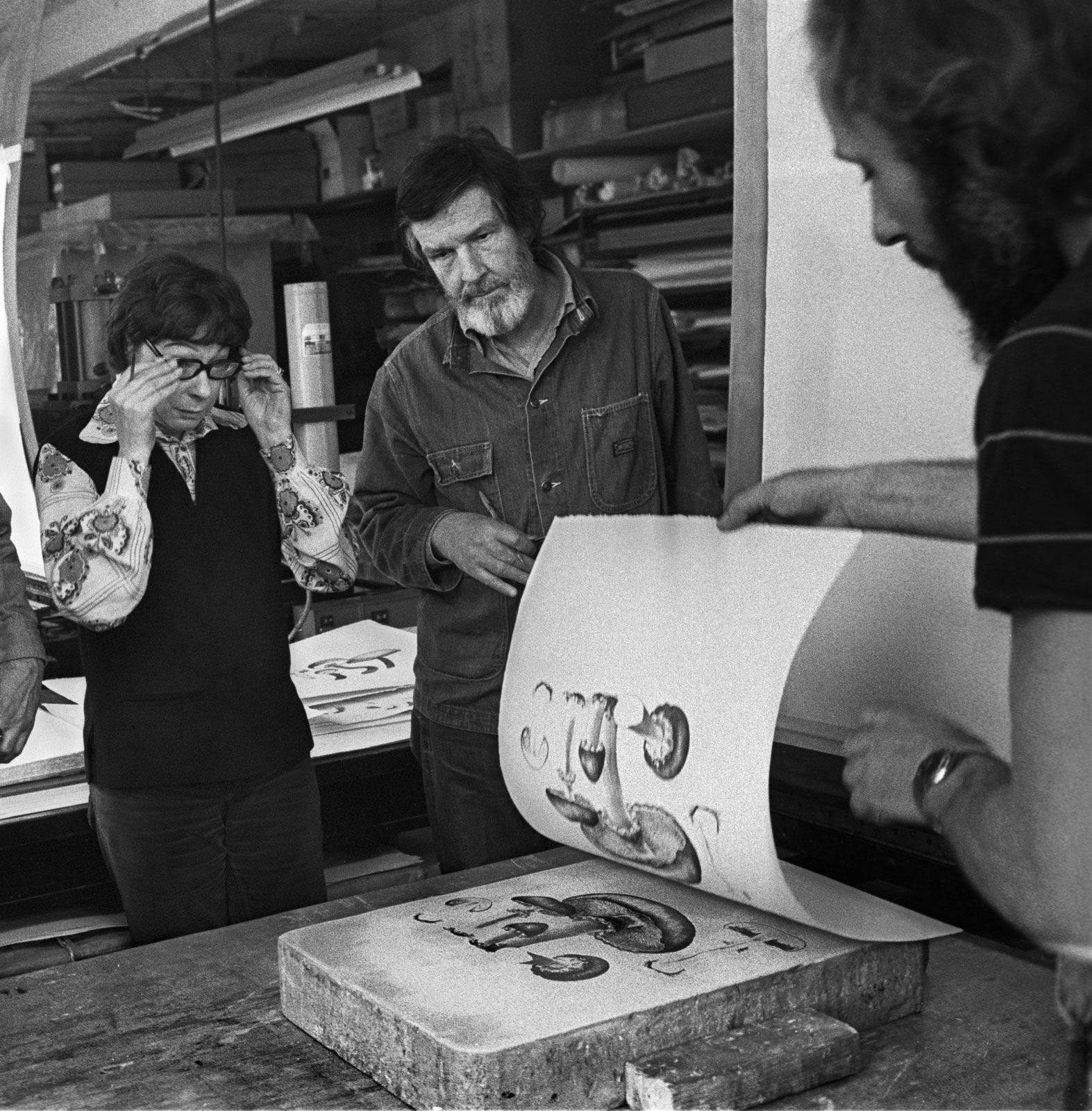 Cage and Lois Long overseeing the printing of Mushroom Book at Hollander Workshop, NY in 1972