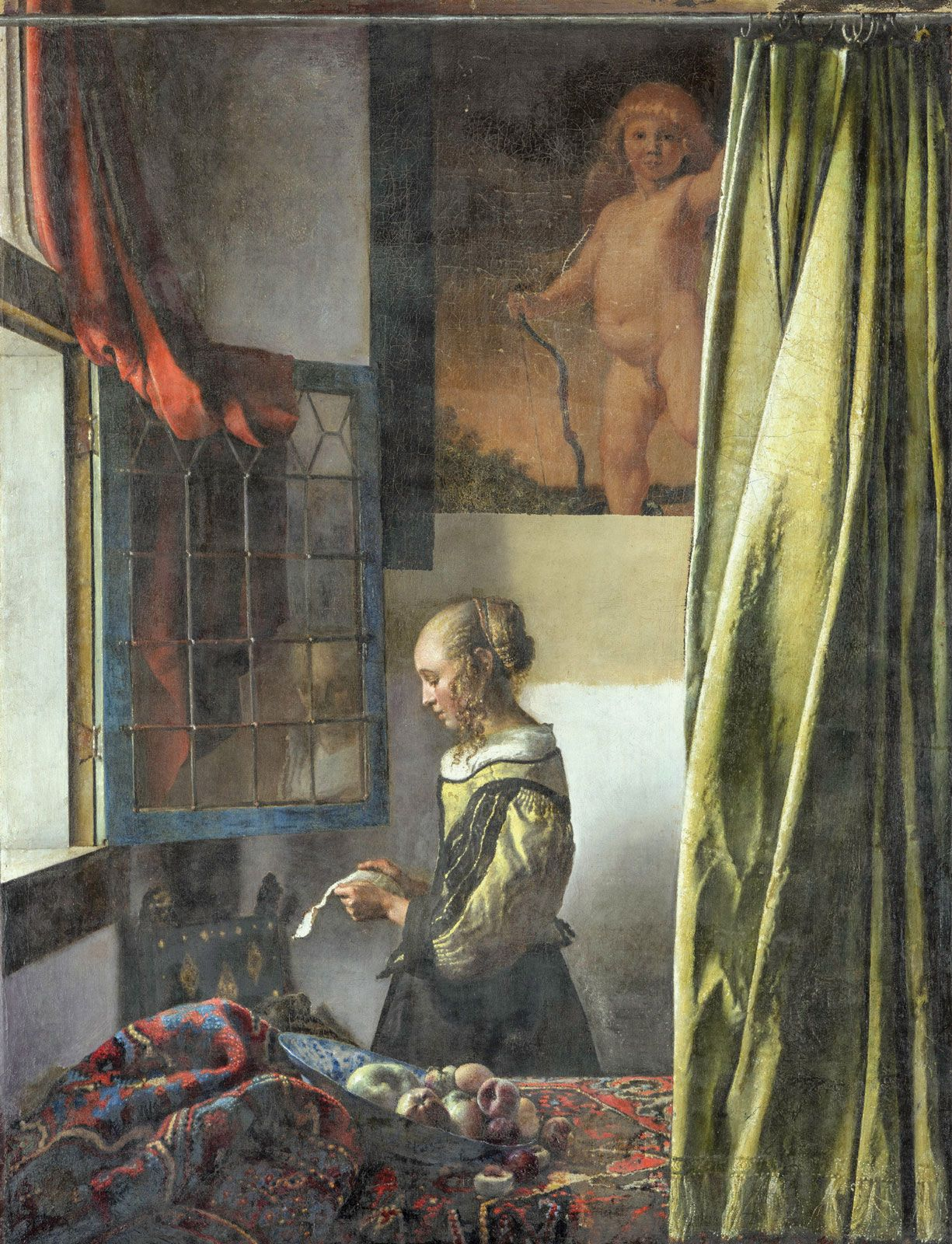 During restoration, a hidden painting  was revealed in Vermeer's Girl Reading a Letter at an Open Window (around 1659)