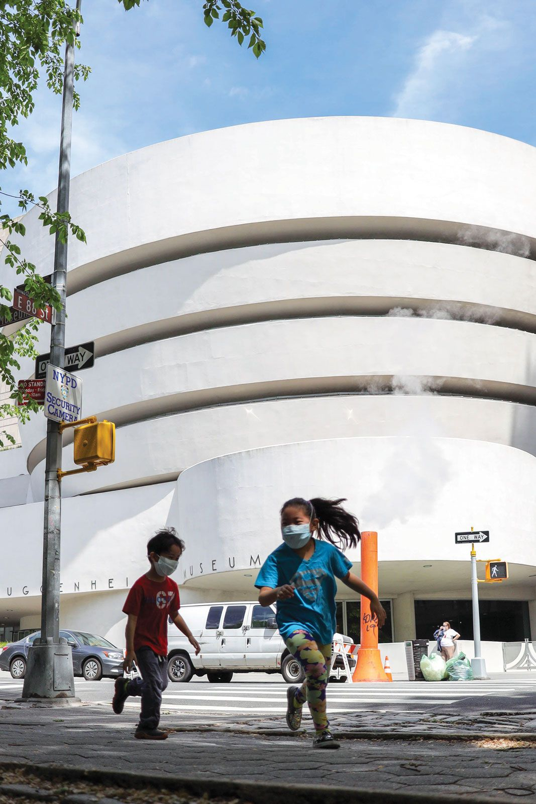 Children playing outside the Solomon R. Guggenheim Museum in New York, which was closed for more than seven months and saw visitor numbers drop by 88%