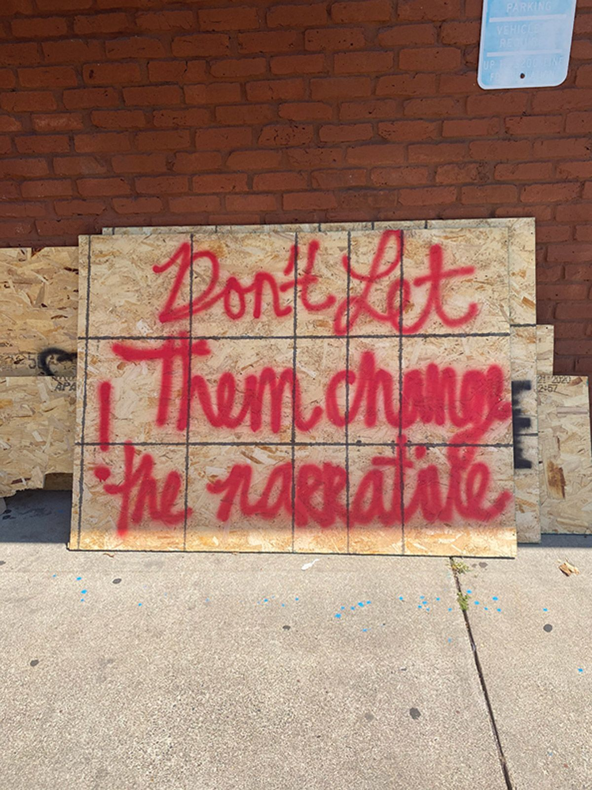 Raw, powerful words written on a board that covered a fast-food restaurant's windows during protests